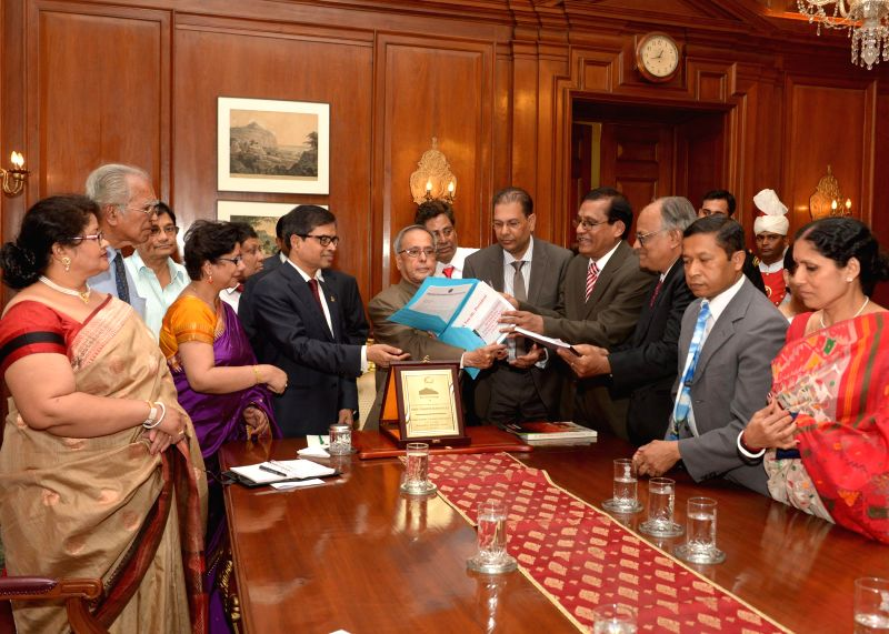 President Pranab Mukherjee meets a delegation of Hindu Buddhist Christian Unity Council (BHBCUC), USA led by Sitangshu Guha at Rashtrapati Bhavan in New Delhi on April 21, 2014.