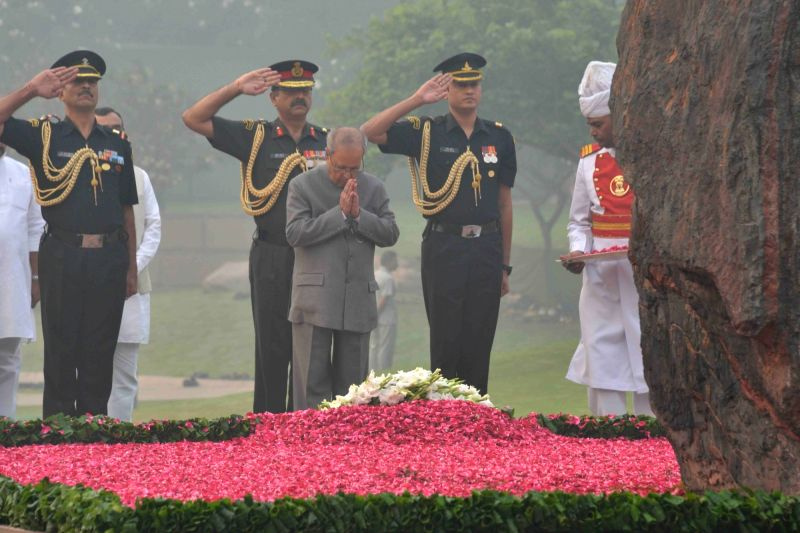 President Pranab Mukherjee, paying homage at the Samadhi of Former Prime Minister Indira Gandhi to commemorate her 31st death anniversary at Shakti Sthal, New Delhi on Oct 31, 2015. - Pranab Mukherjee