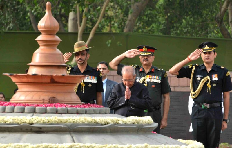 President Pranab Mukherjee paying homage at the Samadhi of the former Prime Minister, late Rajiv Gandhi, on his 26th Anniversary of Martyrdom, at Vir Bhoomi, in New Delhi on May 21, 2017. - Pranab Mukherjee