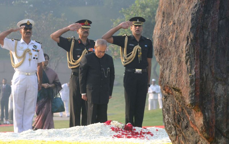 President Pranab Mukherjee pays floral tribute at the memorial of the former Prime Minister Indira Gandhi, on her 98th Birth Anniversary, in New Delhi on Nov 19, 2015. - Pranab Mukherjee