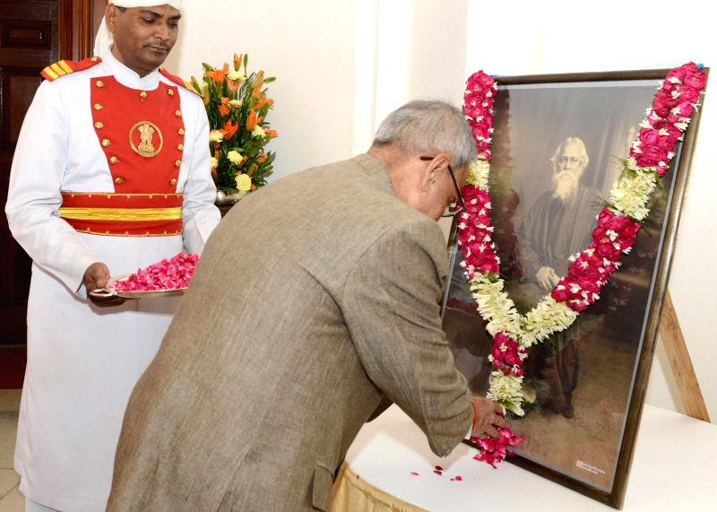 President Pranab Mukherjee  pays floral tribute to Rabindranath Tagore on Rabindra Jayanti (his birth anniversary) at Rashtrapati Bhavan in New Delhi on  May 9, 2014. - Pranab Mukherjee