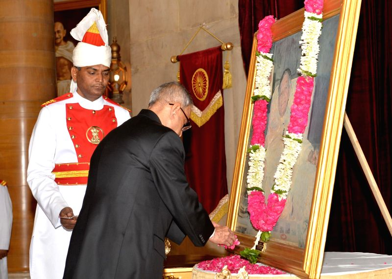 President Pranab Mukherjee pays floral tribute to former President of India Fakhruddin Ali Ahmed on his birth anniversary at Rashtrapati Bhavan in New Delhi on May 13, 2014. - Pranab Mukherjee
