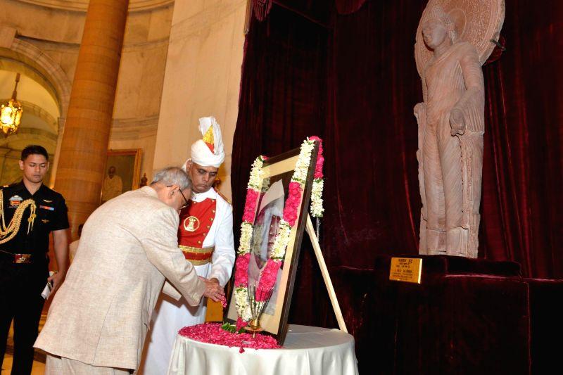 President Pranab Mukherjee pays homage at the portrait of the former President of India Fakhruddin Ali Ahmed on his birth anniversary at Rashtrapati Bhavan, in New Delhi on May 13, 2016. - Pranab Mukherjee