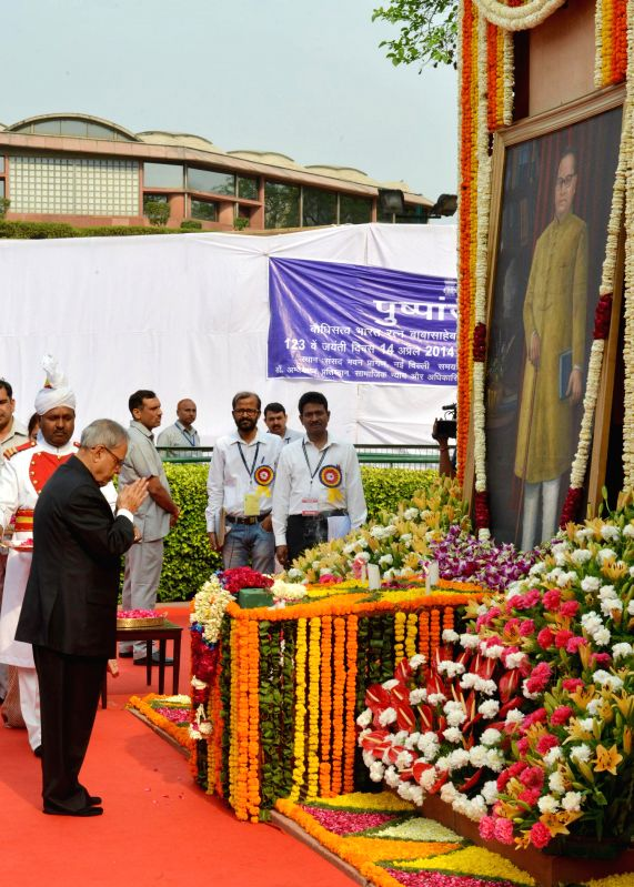 President Pranab Mukherjee pays tribute to Dr. BR Ambedkar on his birth anniversary at the Parliament in New Delhi on April 14, 2014.