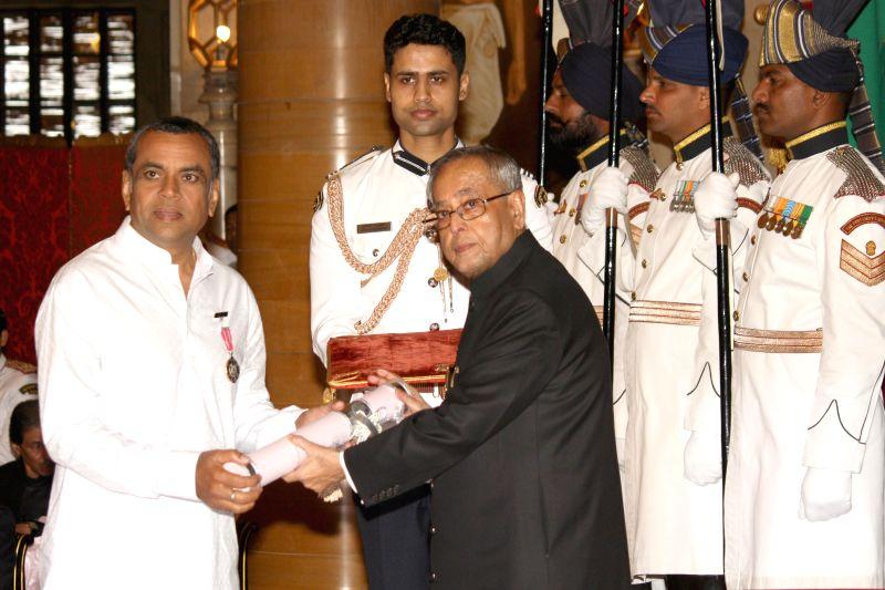 President Pranab Mukherjee presenting the Padma Shri to Paresh Rawal at Rashtrapati Bhawan on April 26,2014. - Pranab Mukherjee