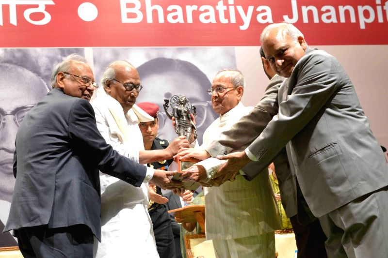 President Pranab Mukherjee presents 52nd Jnanpith Award to Sankha Ghosh at Balyogi Auditorium, Parliament Library Building on April 27, 2017. - Pranab Mukherjee and Sankha Ghosh
