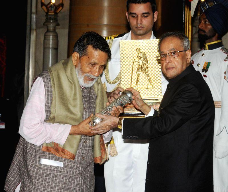 President Pranab Mukherjee presents Gandhi Peace Prize for the year 2013 to Chandi Prasad Bhatt at Rashtrapati Bhavan in New Delhi on July 15, 2014. - Pranab Mukherjee