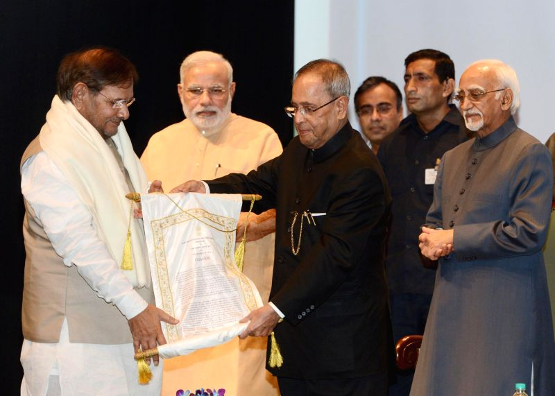 President Pranab Mukherjee presents Outstanding Parliamentarian Award for 2012 to  JD(U) president Sharad Yadav during the presentation ceremony of the Outstanding Parliamentarian Awards for the ... - Narendra Modi, Pranab Mukherjee and Sharad Yadav