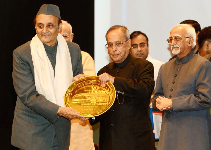 President Pranab Mukherjee presents Outstanding Parliamentarian Award for 2011 to Dr. Karan Singh during the presentation ceremony of the Outstanding Parliamentarian Awards for the years 2010, 2011 .. - Pranab Mukherjee and Karan Singh