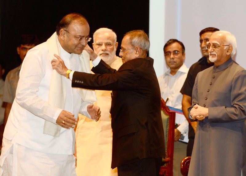 President Pranab Mukherjee presents Outstanding Parliamentarian Award for 2010 to Union Minister for Finance, Corporate Affairs and Defence Arun Jaitley during the presentation ceremony of the ... - Narendra Modi, Pranab Mukherjee and Arun Jaitley