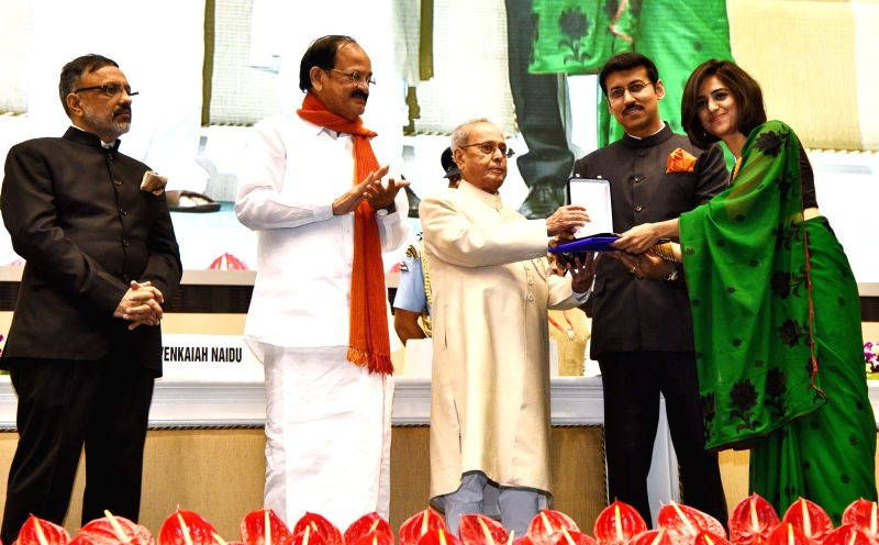 "President Pranab Mukherjee presents Rajat Kamal Award to Director Neha Sharma, for Best Film on Family Values, ""Little Magician"" at the 64th National Film Awards Function, in New ... - M. Venkaiah Naidu, Pranab Mukherjee, Neha Sharma and Rajyavardhan Singh Rathore"