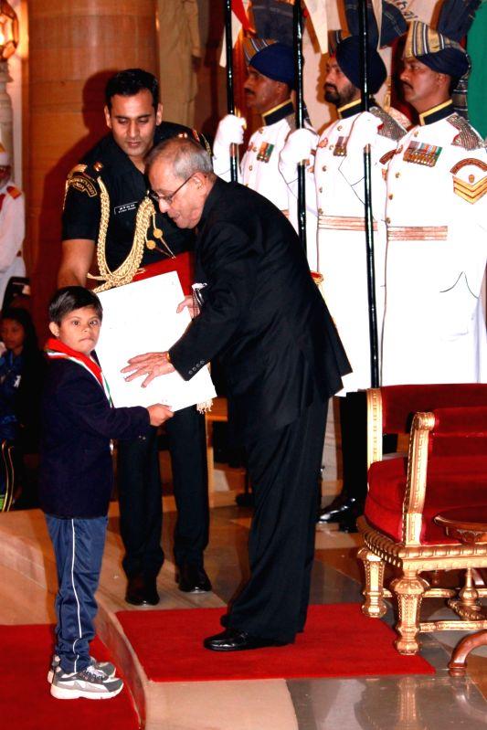 President Pranab Mukherjee presents the National Child Award for Exceptional Achievement 2015 to Palak Kalia, in New Delhi on Nov 14,2015. - Pranab Mukherjee