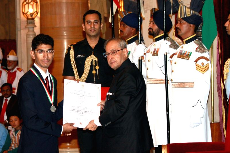 President Pranab Mukherjee presents the National Child Award for Exceptional Achievement 2015 to Aditya Makkar, in New Delhi on Nov 14,2015. - Pranab Mukherjee