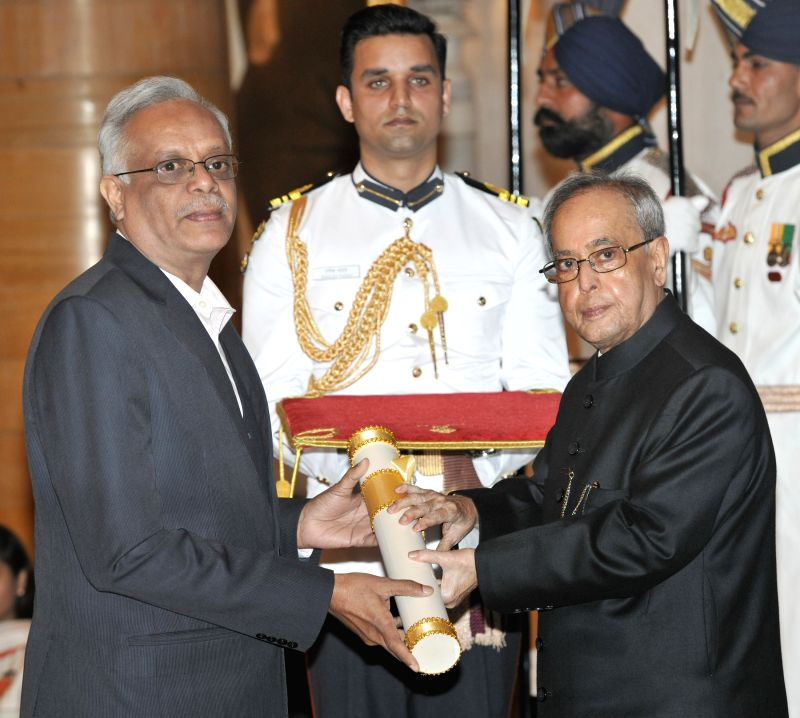 President Pranab Mukherjee presents the Padma Shri Award to Indian scientist S. Arunan during a Civil Investiture Ceremony organised at the Rashtrapati Bhavan in New Delhi on April 8, 2015. - Pranab Mukherjee