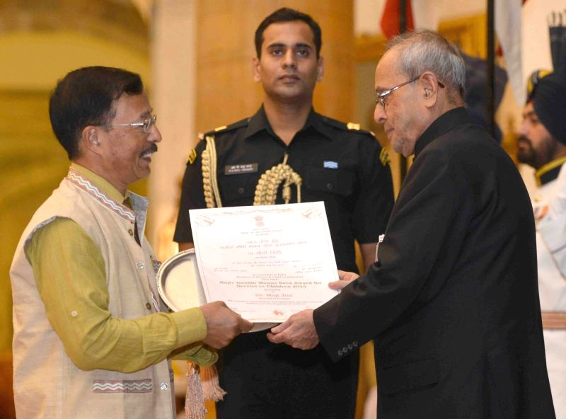 President Pranab Mukherjee presents the Rajiv Gandhi Manav Seva Award 2015, on the occasion of Children's Day, at Rashtrapati Bhavan, in New Delhi on Nov 14, 2015. - Pranab Mukherjee