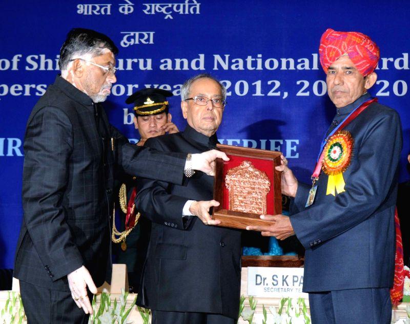 President Pranab Mukherjee presents the Shilp Guru Awards -2014 to Ram Swaroop Sharma (Rajasthan) at the presentation of the National Awards and Shilp Guru Awards to master craftsperson ... - Pranab Mukherjee, Swaroop Sharma and Santosh Kumar Gangwar
