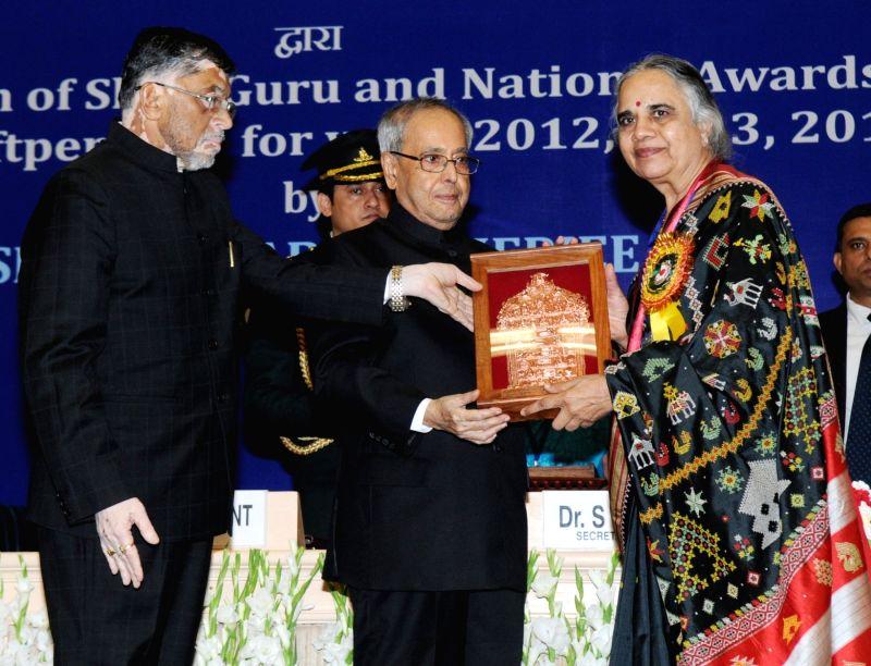 President Pranab Mukherjee presents the Shilp Guru Awards -2013 to Choudapurkar (Karnataka), at the presentation of the National Awards and Shilp Guru Awards to master craftsperson and ... - Pranab Mukherjee and Santosh Kumar Gangwar