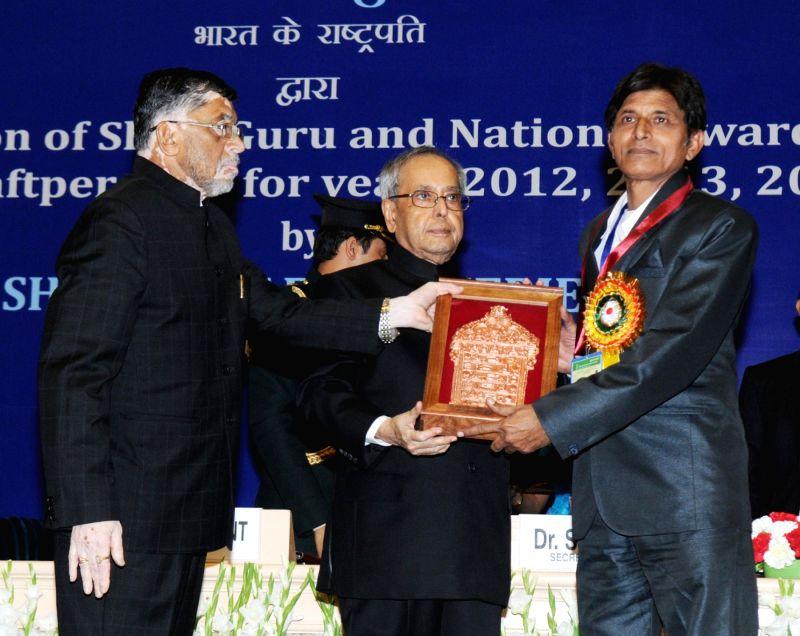 President Pranab Mukherjee presents the Shilp Guru Awards -2013 to Rafiquddin (Uttar Pradesh), at the presentation of the National Awards and Shilp Guru Awards to master craftsperson and ... - Pranab Mukherjee and Santosh Kumar Gangwar
