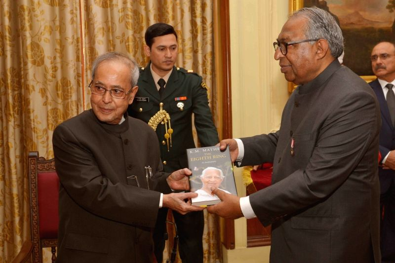 President Pranab Mukherjee receive the first copy of the book entitled `8th Ring` from the Chief Editor, Malayala Manorama Mammen Mathew, at Rashtrapati Bhavan, in New Delhi on Nov 26, ... - Pranab Mukherjee
