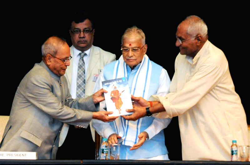 President Pranab Mukherjee receives a copy of the book of Hindi Translation of Bengali Songs of Lalan Shah Fakir by Prof. Muchkund Dubey and a DVD of the Songs during a programme at ... - Pranab Mukherjee and Lalan Shah Fakir