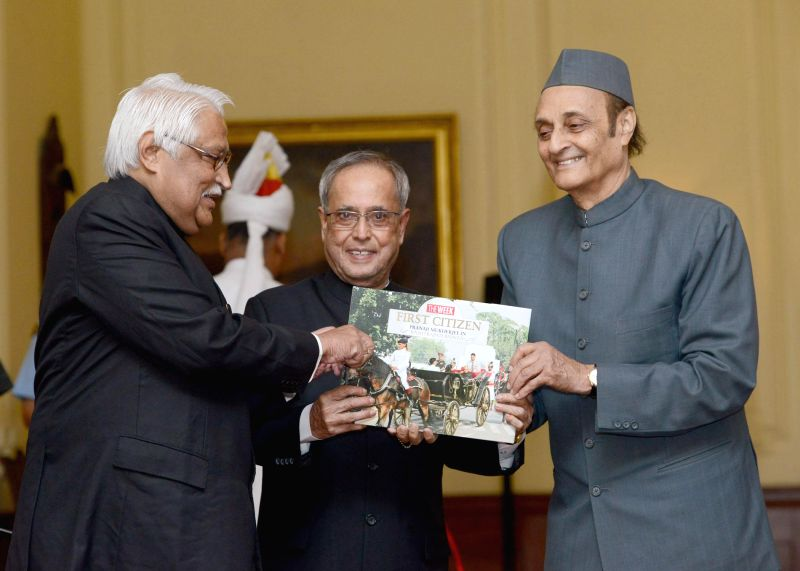 President Pranab Mukherjee receives the first copy of `The First Citizen` - a coffee table book by Malayala Manorama Managing Editor Philip Mathew at Rashtrapati Bhavan in New Delhi on July 2, 2014. . - Karan Singh