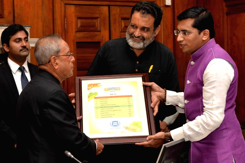 President Pranab Mukherjee, receives the first copy of ``QS BRICS Universities Ranking 2015`` from Manipal Global Education Chairman TV Mohandas Pai at Rashtrapati Bhavan in New Delhi on ... - Pranab Mukherjee