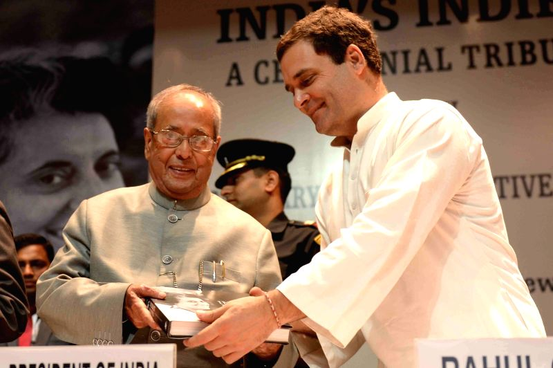 """President Pranab Mukherjee receives the first copy of the book """"India's Indira : A Centennial Tribute"""" from Congress vice-president Rahul Gandhi during a programme in New Delhi ... - Pranab Mukherjee and Rahul Gandhi"""