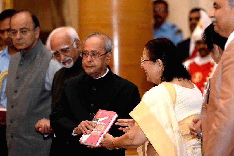 President Pranab Mukherjee receives the first copy of the book 'Mann Ki Baat - A Social Revolution of Radio' from Lok Sabha Speaker Sumitra Mahajan at Rashtrapati Bhavan on May 26, 2017. ... - Sumitra Mahajan and Pranab Mukherjee