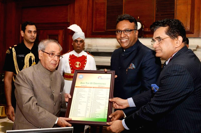 "President Pranab Mukherjee receives the ""State of Indian Universities in the Global Academic Rankings"" (Asia Top 25) from Amitabh Kant and Dr. C Raj Kumar, at Rashtrapati Bhavan, ... - Pranab Mukherjee and C Raj Kumar"