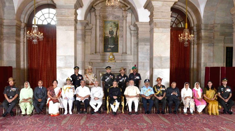 President Pranab Mukherjee, the Vice President Mohd. Hamid Ansari, the Prime Minister Narendra Modi, the Union Minister for Defence Manohar Parrikar and other dignitaries at the Defence Investiture ... - Narendra Modi and Pranab Mukherjee