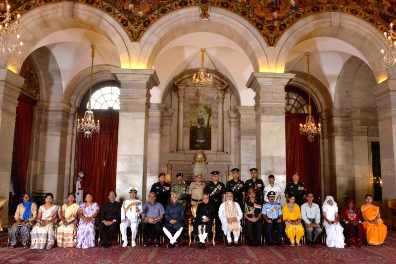 President Pranab Mukherjee, the Vice President M. Hamid Ansari, the Prime Minister Narendra Modi, the Union Minister for Defence Manohar Parrikar and other dignitaries during the Defence ... - Narendra Modi and Pranab Mukherjee