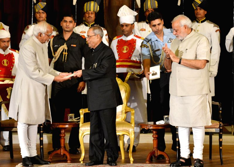 President Pranab Mukherjee, Vice President Hamid Ansari and Prime Minister Narendra Modi during release of the book ``Thoughts and Reflection``, (Compilation of Quotation of the President) at ... - Narendra Modi and Pranab Mukherjee