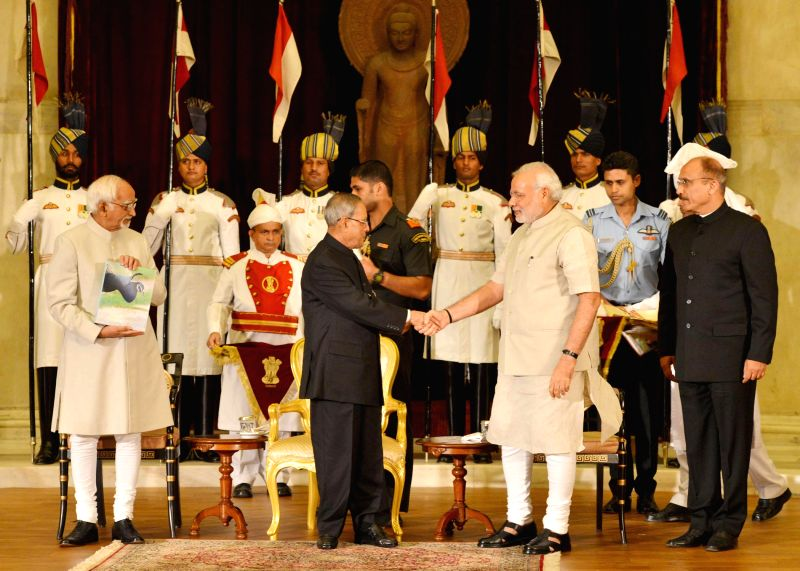 President Pranab Mukherjee, Vice President Hamid Ansari and Prime Minister Narender Modi during release of a book titled ``The Wing Wonders of Rashtrapati Bhavan`` authored by Dr. Thomas Mathew, ... - Narender Modi and Pranab Mukherjee