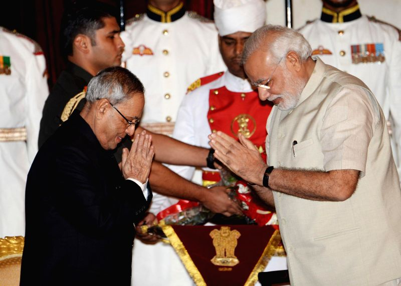 President Pranab Mukherjee, Vice President Hamid Ansari and Prime Minister Narender Modi during release of a book titled ``Indradhanush`` authored Siddharth Sharma, Internal Financial Advisor in ... - Narender Modi, Pranab Mukherjee and Siddharth Sharma