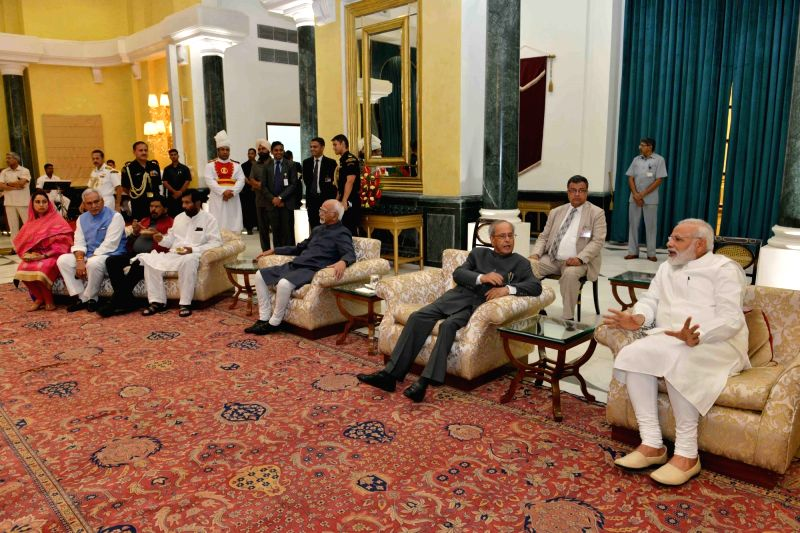 President Pranab Mukherjee, Vice President Hamid Ansari and Prime Minister Narendra Modi attend the reception on the occasion of Civil Services Day at Rashtrapati Bhavan Cultural Centre ... - Narendra Modi and Pranab Mukherjee