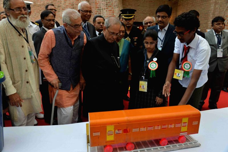 President Pranab Mukherjee visits an exhibition at the Institute of Management - Ahmadabad (IIMA), in Gujarat on Nov 30, 2015. Also seen the Gujarat Governor O P Kohli and Chief Minister ... - Anandiben Patel, Pranab Mukherjee and O P Kohli