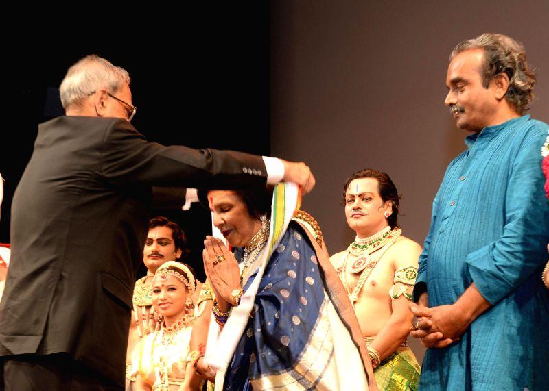 President Pranab Mukherjee with artists of Shriram Bharatiya Kala Kendra who performed at Rashtrapati Bhavan Auditorium in New Delhi on Aug 19, 2014. - Pranab Mukherjee