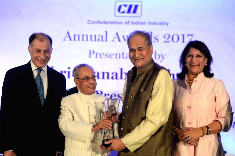 President Pranab Mukherjee with Bajaj Auto chairman Rahul Bajaj (L) and CII President, Naushad Forbes during a CII Award function in New Delhi, on April 27, 2017. - Pranab Mukherjee