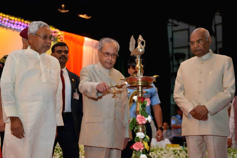 President Pranab Mukherjee with Bihar Governor Ram Nath Kovind and Chief Minister Nitish Kumar during inauguration of a programme organised to felicitate freedom fighters on Centenary of ... - Nitish Kumar, Pranab Mukherjee and Nath Kovind