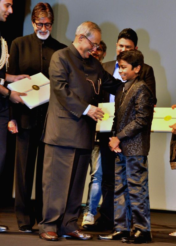 President Pranab Mukherjee with child actor Parth Bhalerao during a special screening of his film at Rashtrpati Bhavan Auditorium in New Delhi on April 17, 2014. - Parth Bhalerao and Pranab Mukherjee
