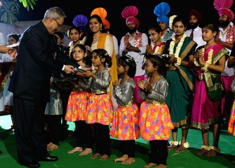 President Pranab Mukherjee with children during inauguration of 'Street Food Festival' organised on Baisakhi at President's Estate in New Delhi on April 14, 2014. - Pranab Mukherjee
