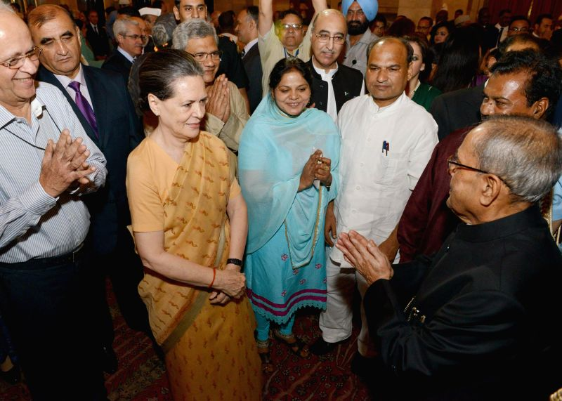President Pranab Mukherjee with Congress president Sonia Gandhi during an Iftar Party at the Rashtrapati Bhawan in New Delhi on July 21, 2014. - Pranab Mukherjee and Sonia Gandhi
