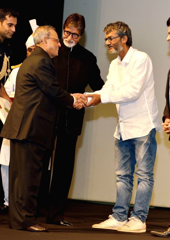 President Pranab Mukherjee with filmmaker Nitesh Tiwari and other actors of 'Bhootnath Returns', during a special screening of the film at Rashtrpati Bhavan Auditorium in New Delhi on April 17, 2014. - Pranab Mukherjee