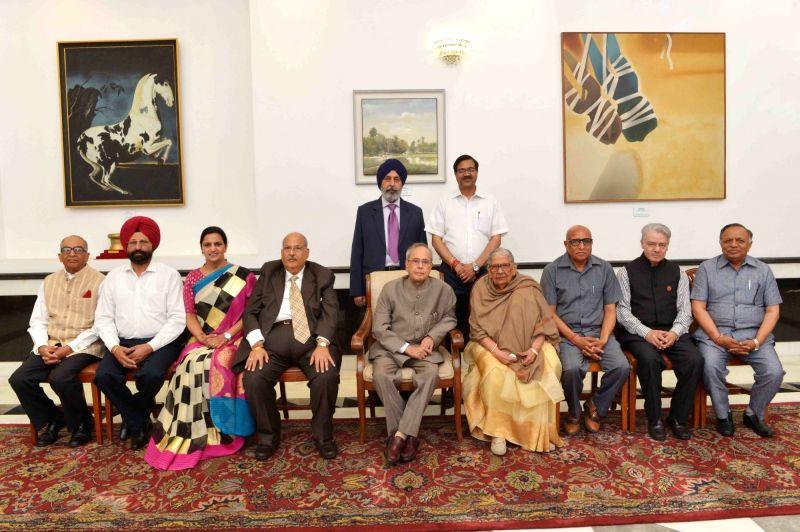 President Pranab Mukherjee with Malti Gyan Peeth Puruskar awardees at Rashtrapati Bhawan in New Delhi on May 29, 2016. - Pranab Mukherjee