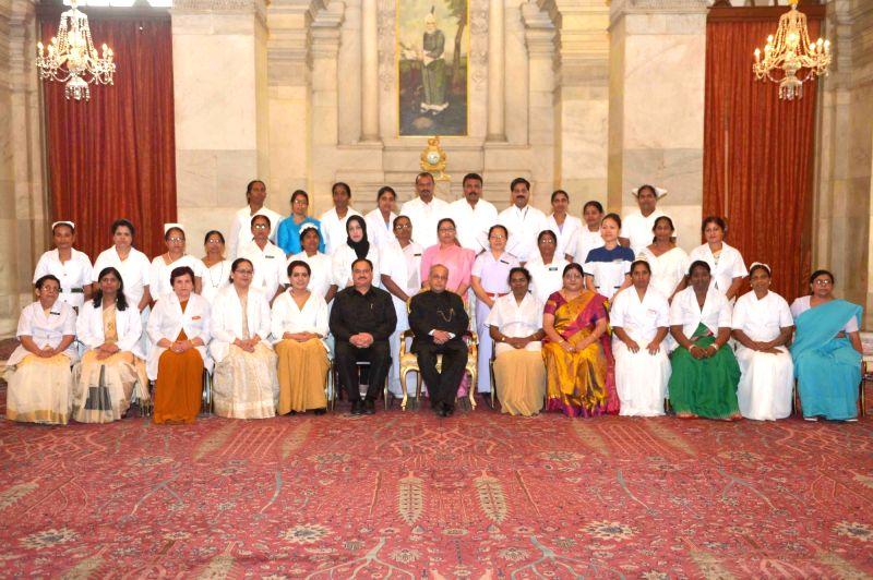 President Pranab Mukherjee with nurses who won National Florence Nightingale Awards on International Nurses' Day at Rashtrapati Bhavan on May 12, 2017. (Photo: IANS/RB) - Pranab Mukherjee