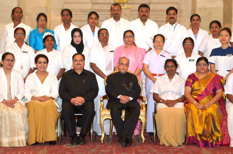 President Pranab Mukherjee with nurses who won National Florence Nightingale Awards on International Nurses' Day at Rashtrapati Bhavan on May 12, 2017. - Pranab Mukherjee