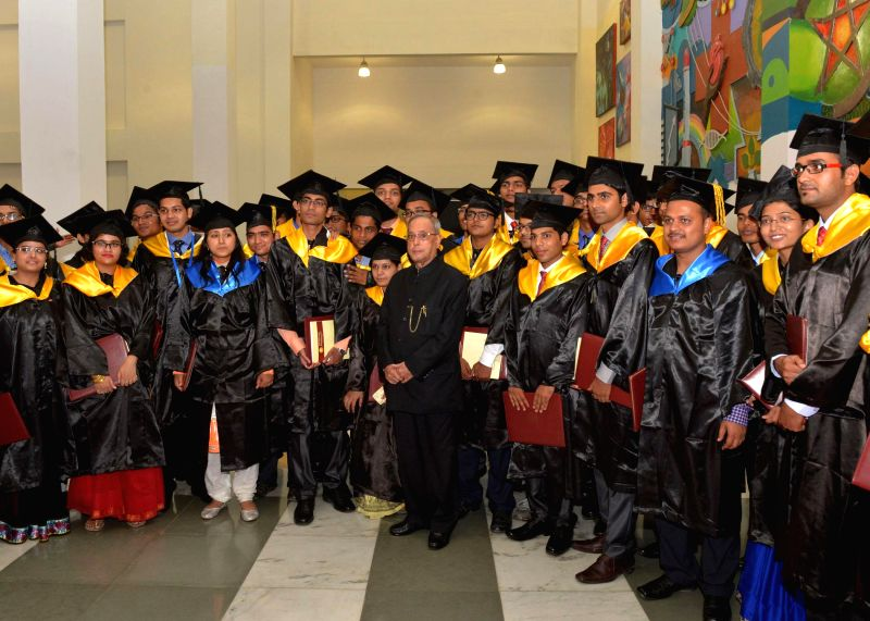 President Pranab Mukherjee with students during the golden jubilee convocation of Jawaharlal Nehru Krishi Vishwa Vidyalaya at Jabalpur in Madhya Pradesh on June 27, 2014. - Pranab Mukherjee