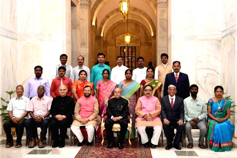 President Pranab Mukherjee with the recipients of the Presidential Awards for Classical Tamil for the years 2013-14, 2014-15 and 2015-16 at Rashtrapati Bhavan in New Delhi on May 9, 2017. ... - Pranab Mukherjee and Mahendra Nath Pandey