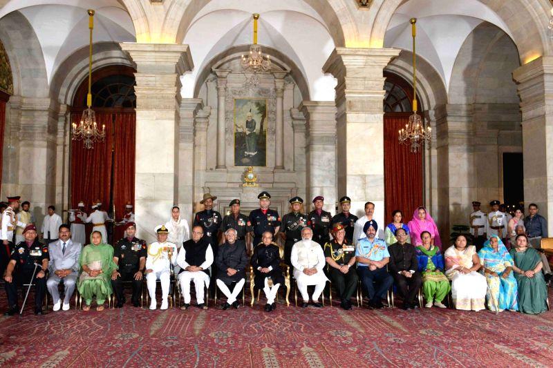 President Pranab Mukherjee with the winners of the Gallantry Awards & Distinguished Service Decorations (PVSM(16), Kirti Chakra (01), UYSM (03), Bar to AVSM (01), AVSM (22) & ... - Narendra Modi, Pranab Mukherjee and Arun Jaitley