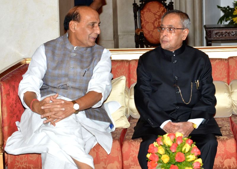 President Pranab Mukherjee with Union Home Minister Rajnath Singh during an Iftar Party at the Rashtrapati Bhawan in New Delhi on July 21, 2014. - Rajnath Singh and Pranab Mukherjee